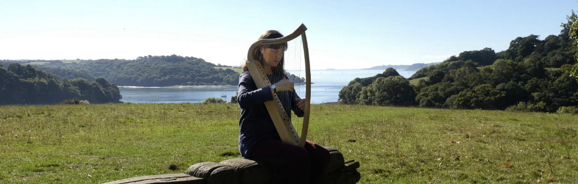 nw playing a medieval harp at trelissick